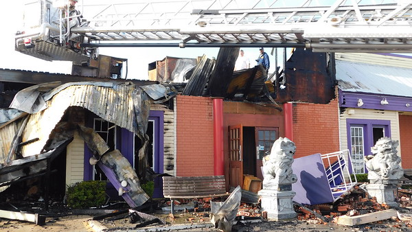 KENTON BROOKS/Muskogee Phoenix<br /> Fire Marshal Derrell R. Jones, right, and Assistant Fire Chief Gordon Lee look over the damage caused by an early Monday morning fire at the China King Super Buffet at 231 W. Shawnee Bypass. The fire, Lee said, started inside the restaurant and caused an estimated $400,000 in damage and was electrical in nature.