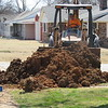 CATHY SPAULDING/Muskogee Phoenix<br /> Tony Lott moves dirt while working on a water line replacement at Hickory Avenue and Beauregard Street. Water lines are being replaced at various places throughout Fort Gibson, including along Hickory Avenue between Jackson and Beauregard streets and along Beauregard between Hickory Avenue and Cottonwood Street. The replacements were funded through a REAP grant and town funds.