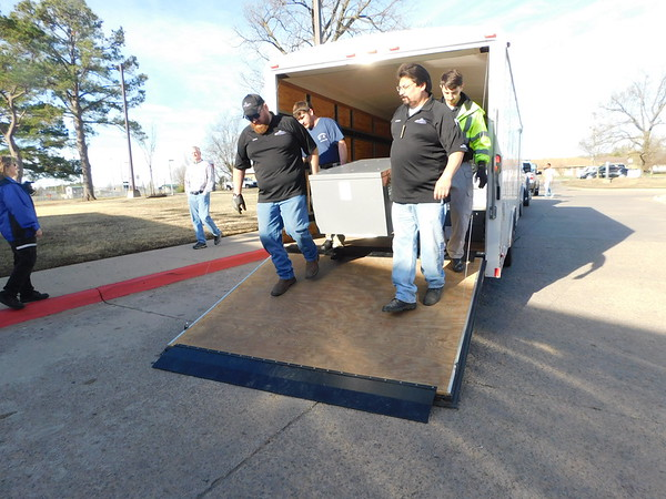 KENTON BROOKS/Muskogee Phoenix<br /> Members of the Muskogee County EMS Region 4 Disaster Medical Response Team unload a truck Wednesday that holds a portable triage tent at Saint Francis Hospital Muskogee. The triage, which operated by Saint Francis Hospital Muskogee, will be set up in the Emergency Room area. The workers, from left, include Chris Tinsley, Jay Brown, Anthony Zinno and Colby Menie.