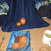 CATHY SPAULDING/Muskogee Phoenix<br /> James Harelson's acrylic painting sits by the clementine and apple he used as models.