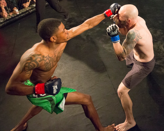 Special photo by Von Castor<br /> Jeremy Vaughn lands a left to the head of Ken Hartley during their bout Saturday at the Muskogee Civic Center.
