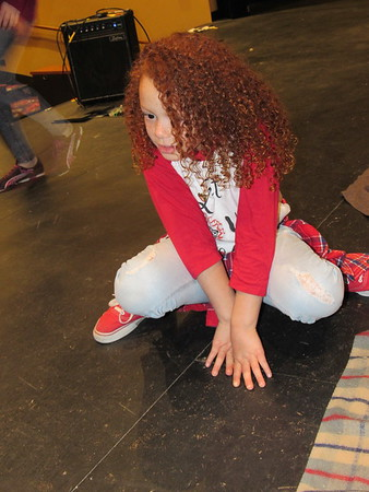 "CATHY SPAULDING/Muskogee Phoenix<br /> Evy Mitchell acts like an animal during a warm-up to play practice. Evy got the lead role in the Muskogee Little Theatre production, ""Annie."""