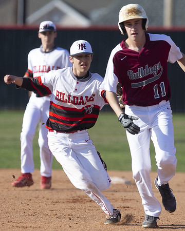 VON CASTOR/Phoenix Special Photo<br /> Hilldale shortstop Landon Evans runs down a Muldrow baserunner for the putout Tuesday afternoon at Hornet Field.