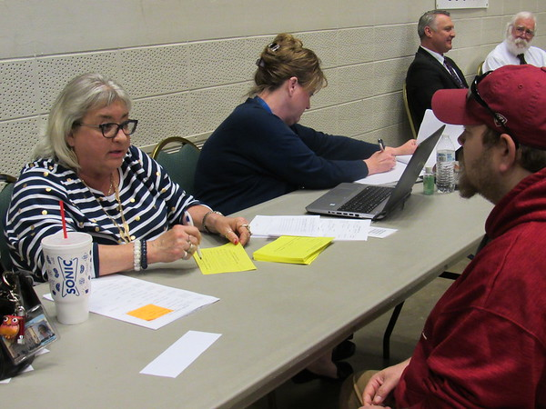 CATHY SPAULDING/Muskogee Phoenix<br /> Muskogee County District Court Clerk Paula Sexton talks with Charles Evans II during the Tuesday session of Amnesty Day. A second amnesty day will be 2 to 6 p.m. Wednesday at the Muskogee Civic Center. The purpose of Amnesty Day is to assist anyone who has an arrest warrant in the City of Muskogee or Muskogee County District Court by removing their warrant(s) and re-establishing a payment plan for any outstanding fees.