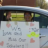 CATHY SPAULDING/Muskogee Phoenix<br /> New Tech at Cherokee Elementary second-grade teacher Lori Boatright waves from the back seat of her car at the start of Thursday night's teacher parade through neighborhoods.