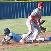 Phoenix special photo by John Hasler<br /> Oktaha's Matt Irwin steals second as Dale's David Herring knocks down the throw during Monday's game at Oktaha.
