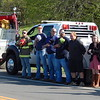 Staff photo by Cathy Spaulding<br /> Volunteer firefighters from departments across McIntosh County stand along Oklahoma 9 and remove their hats in honor of slain Tecumseh Police officer Justin Terney, whose body was being taken to a Eufaula funeral home. Departments included Onapa, Eufaula, Vivian, Porum Landing, Texanna and Shady Grove/Central High.