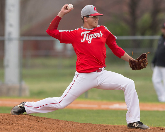 Phoenix special photo by Von Castor<br /> Fort Gibson's Brandon Downey uncorks a fastball Monday at Carr-O'Dell Tiger Park against Okmulgee. The Tigers won the game 7-0.