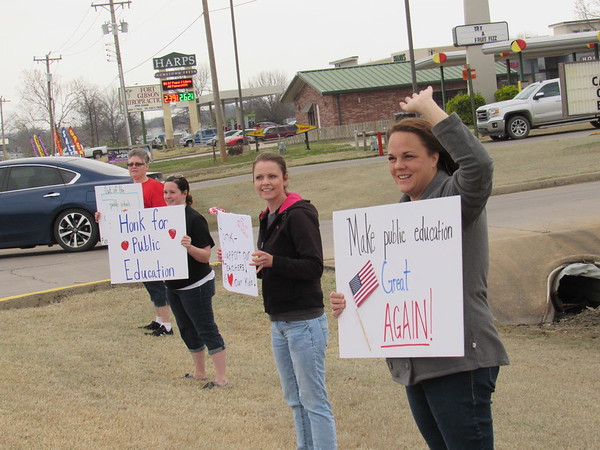 CATHY SPAULDING/Muskogee Phoenix<br /> Fort Gibson teachers and parents hold up signs Friday, soliciting support for public education funding. They are, from left, library assistant Krista Coombes, special<br /> education teacher Katie Russell, parent Jennifer Parker and kindergarten teacher Jeraka Ireland.