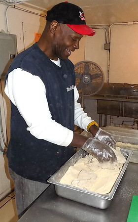 MIKE ELSWICK/Muskogee Phoenix<br /> Harry Roberts hand breads each piece of fish fresh daily in a specially seasoned mixture.