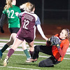 VON CASTOR/Phoenix special photo<br /> Muskogee goalkeeper Hailey Miller saves a goal off the foot of Jenks' Chloe Labadie in Tuesday night's game on Creek Nation Field.