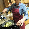 CATHY SPAULDING/Muskogee Phoenix<br /> Vinnie Hoover of Fife Indian United Methodist Church mixes scrambled eggs in fried wild onions. Church members will prepare much more onions and eggs at their annual Wild Onion Dinner on Friday.