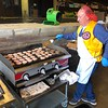 CHESLEY OXENDINE/Muskogee Phoenix<br /> Volunteer Brian Meadows flips sausage patties during the Noon Lions Club's Pancake Day Wednesday morning.