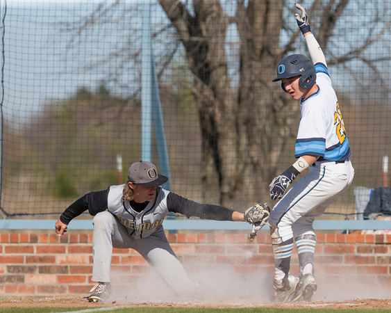 Special photo by Von Castor<br /> Oktaha's Korey Walker, right, slides into home safely ahead of the tag by Okemah's Jacob Rogers during Monday's game in Oktaha.
