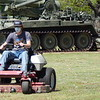 Staff photo by Mark Hughes<br /> Austin Ellison, a senior at Oktaha High School, wears a dust<br /> mask as he operates a zero-turn riding lawnmower at Muskogee's War Memorial Park on Tuesday. Ellison also attends service career classes at Indian Capital Technology Center. He's also learning to drive a forklift.