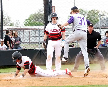 Phoenix special photo by John Hasler Hilldale's Dee Folsom slides safely across home plate before Bristow's Matt Floyd, right, has a chance to tag him while Folsom's teammate Kort Morgan, center, watches during Tuesday's game at Hilldale.