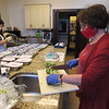 CATHY SPAULDING/Muskogee Phoenix<br /> Pat Wilcox, left, and Francie Wright wear protective masks and gloves while preparing meals for shut-ins Wednesday at Grace Episcopal Church.