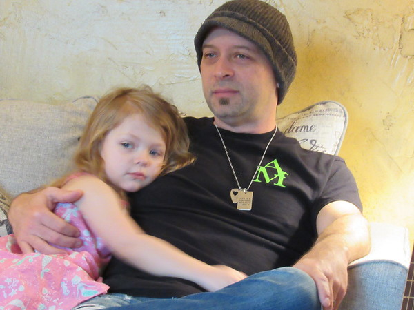 CATHY SPAULDING/Muskogee Phoenix<br /> Aaron Hobbs rests with his 3-year-old daughter Arabella. He said he cherishes time with his family.