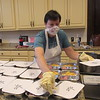 CATHY SPAULDING/Muskogee Phoenix<br /> Pat Wilcox wears protective gloves and mask while preparing Meals on Wings at Grace Episcopal Church.