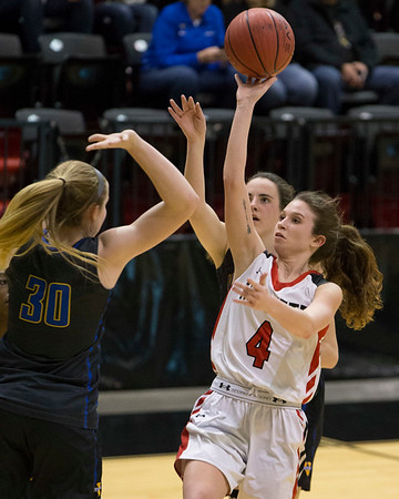 Phoenix special photo by Von Castor<br /> Hilldale's Tyler McMillan shoots over Victory Christian's Taylor Sanders Thursday in a Class 4A Area II Area consolation game at Skiatook. The Lady Hornets won 57-45.