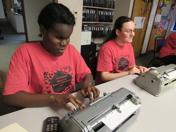 Staff photo by Cathy Spaulding<br /> Oklahoma School for the Blind sophomores TaiYauri Thomas, left, and Richelle Zampella get their Braille typewriters going.