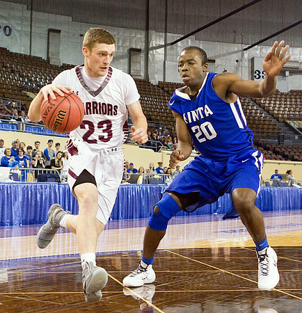 Phoenix special photo by Samuel Perry<br /> Tommy Coppin drives the lane against a Kinta defender in Thursday's Class B state quarterfinal at the Fairgrounds in Oklahoma City. Kinta defeated the Warriors 69-52.