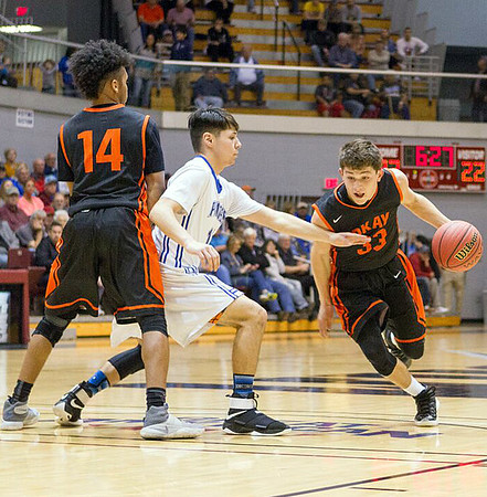Phoenix special photo by Samuel Perry<br /> Austin Skiles of Okay, right, works off a screen set by Lloyd Houston in Thursday's Class A quartefinal win against Cyril at Southern Nazarene University.