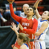 Phoenix special photo by Von Castor<br /> Fort Gibson's Alexis Wright splits two Vinita defenders to score Friday night in the Class 4A Area 2 championship game at Skiatook. The Lady Tigers won 49-23 to punch their 14th straight state tournament ticket.