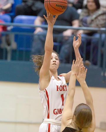 VON CASTOR/Special to the Phoenix<br /> Fort Gibson's Zoey Whiteley shoots over Inola's Madison Courtney on Saturday during the Class 4A Area IV consolation championship game. The Lady Tigers won 37-27 to advance to their 15th straight state tournament.