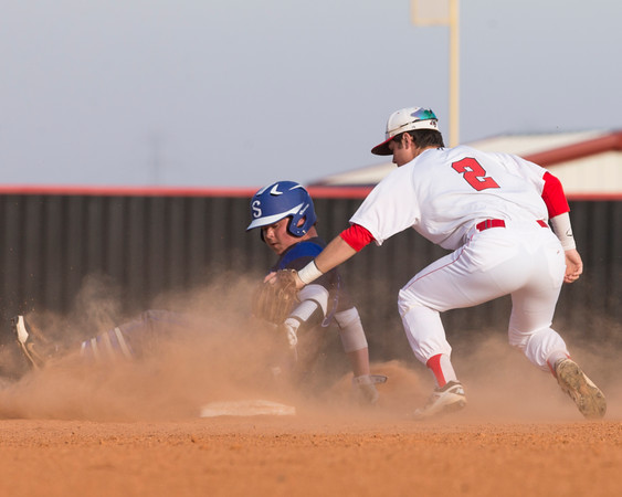 Phoenix special photo by Von Castor<br /> Hilldale shortstop Dawson Hogner tags Claremore Sequoyah's Levi Lewis on a play at second after a pickoff throw from catcher Kort Morgan. Hilldale won 8-0.