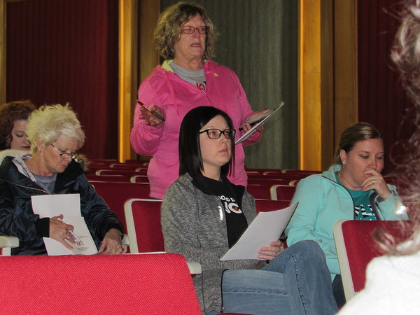 CATHY SPAULDING/Muskogee Phoenix<br /> Fort Gibson paraprofessional Cynthia Andrews stands to share concerns during a meeting in the high school auditorium. The meeting focused on remaining concerns about newly passed legislation increasing teacher pay, support pay and education funding.