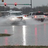 CATHY SPAULDING/Muskogee Phoenix<br /> A pickup splashes through standing water on Main Street, south of Shawnee Bypass on Friday. A sudden rainstorm swamped Muskogee late Friday morning. Potential Saturday morning showers are expected to give way to sunny weather by Sunday, according to AccuWeather's web page.