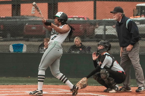 JOHN HASLER/Phoenix Special Photo<br /> Muskogee's Phynix Coleman leads off the first game of the Muskogee Slugout with a home run, moments before the skies opened. The game resumed in Broken Arrow later that day.