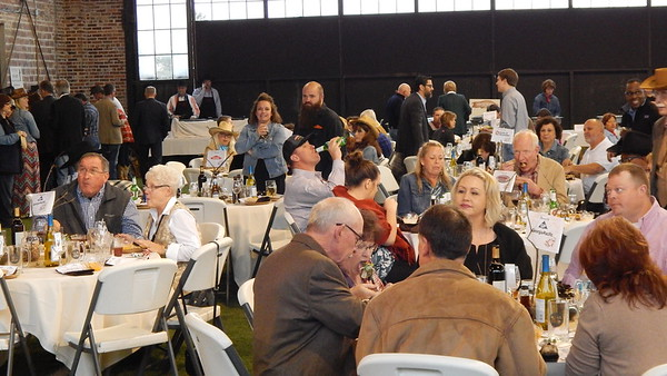 """Staff photo by Wendy Burton<br /> Diners enjoy """"chuckwagon steaks"""" and all the trimmings at the 94th annual Greater Muskogee Area Chamber of Commerce Banquet Thursday."""