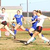 JOHN HASLER/Phoenix special photo<br /> Hilldale's Savannah Jorgenson, right, looks to gain possession in the first half against Porter on Friday. Also<br /> pictured, from left, is Hilldale's Destiny Ladd, Porter's Hallee Boyd and Bobby Jackson.