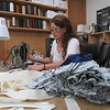 CATHY SPAULDING/Muskogee Phoenix<br /> Thayer Upholstery worker Georgina Aldana keeps stacks of precut fabric handy as she sews medical face masks on Saturday.