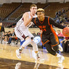 Phoenix special photo by Samuel Perry<br /> Okay High School's Darius Riggs charges past  a Velma-Alma defender. -Photo by Samuel Perry.
