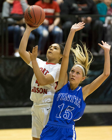 Phoenix special photo by Von Castor<br /> Fort Gibson's Alexis Wright, left, shoots over Vinita's Kaitlin Benge during Friday's Class 4A Area II final at Skiatook. The Lady Tigers won 64-59 in double overtime to advance to their 13th straight state tournament.