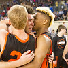 Phoenix special photo by Samuel Perry<br /> Okay's Caleb Riggs, center, is hugged by his brother Darius, right, and Kaleb Pierce after Caleb's buzzer-beating jumper in the lane beat Pond Creek-Hunter 72-71 in overtime in Friday's Class A semifinal in Oklahoma City.