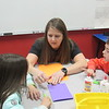 CATHY SPAULDING/Muskogee Phoenix<br /> Hilldale Elementary art teacher Jamie Triplett helps student Ella Brunson, left, with an art lesson while classmate Landon Robinson watches. Triplett has been selected Hilldale's 2020 Teacher of the Year.