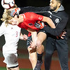 VON CASTOR/ Special to the Phoenix<br /> Hilldale's Niky Harper tries for a header as the Holland Hall goalkeeper tries to punch the ball Tuesday night at Hilldale.