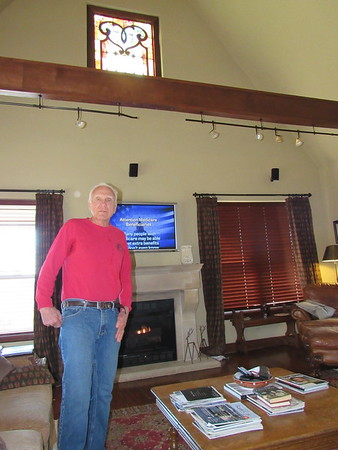 Staff photo by Cathy Spaulding<br /> A stained glass window from the old First Presbyterian Church brings light into Jim Webb's living room. Webb built the house.
