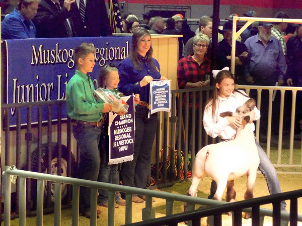 Special photo by Wendy Burton<br /> Jana Stacy, from Oktaha 4-H, shows her Grand Champion Lamb as the first animal to go up for premium sale at the 77th annual Muskogee Regional Junior Livestock Show. Stacy's lamb brought a $3,000 bid from Brinkley's Auction Service in Idabel, Okla.