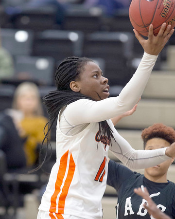 VON CASTOR/Special to the Phoenix<br /> Connors' Vicky Duru scores in the lane Monday evening against Arkansas Baptist College at Connors State in Warner. The Cowgirls won 61-41 to advance to the NJCAA Region II quarterfinals.