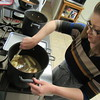 Staff photo by Cathy Spaulding<br /> Melissa Wedman constantly stirs her caramel-butter mixture while making candy.