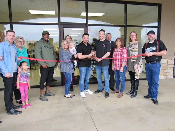 Staff photo by Cathy Spaulding<br /> Supporters, business owners and Fort Gibson Chamber of Commerce officials join the ribbon cutting for Limitless Nutrition. They are, from left, Zach Robinson, Scout Sapulpa, Pat Green of Fort Gibson State Bank, Soulja Fit owner P.J. Cowan, Brianna Trujillo, Lillie Robinson, 1-year-old Liam Griggs, Limitless Nutrition co-owner John Griggs, Limitless Nutrition co-owner Alex Miller, Fort Gibson Chamber of Commerce Vice President Cliff Garrett, past chamber chairwoman Denise Bain, associate chamber board member Tonia Cooper, and chamber member Trey Reed.
