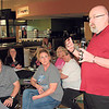 Staff photo by Cathy Spaulding<br /> Muskogee Education Association President Mike Walcutt, standing, discusses a potential statewide teacher walkout with MEA members at a special meeting Monday.
