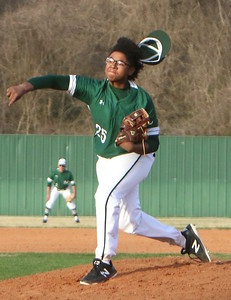 Phoenix special photo by John Hasler Rougher freshman Pryce Jackson throws off the mound in windy conditions that saw gusts of 45 mph Tuesday. Jackson and the Roughers lost 8-0.