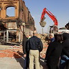 Staff photo by Mike Elswick<br /> Wagoner Mayor Albert Jones, left, discusses with others demolition of a historic downtown building Tuesday afternoon after high winds caused the burned-out facade to sway, resulting in public safety concerns.
