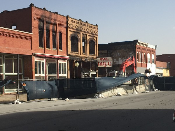 Staff photo by Mike Elswick A historic downtown Wagoner structure was demolished Tuesday as high winds resulted in safety issues when bricks from the top of the second story started falling about noon.